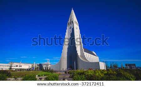 Hallgrimskirkja Cathedral in Reykjavik, Iceland, lutheran parish church, exterior in a sunny summer day with a blue sky - stock photo