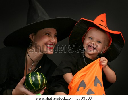 Halloween - baby and mother - stock photo