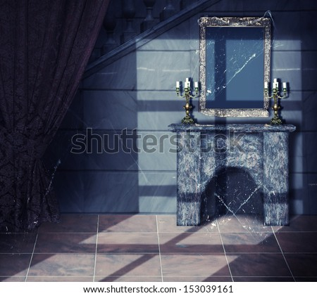 Halloween background.Interior - gold frame, web, candlestick and fireplace in old Abandoned castle - stock photo