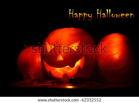 Halloween background with glowing jack-o-lantern in the darkness - stock photo