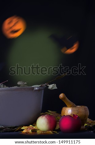 Halloween background with mortar, apple and pumpkin - stock photo