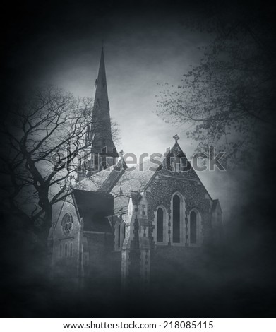 Halloween background with spooky and ancient church over smoky background  - stock photo