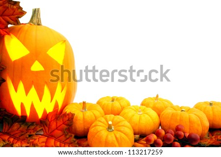 Halloween border with jack-o-lantern, pumpkins and autumn leaves over white - stock photo