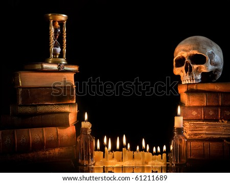 Halloween border with skull, ancient books and candles - stock photo