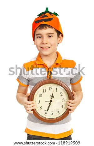 Halloween boy with pumpkin hat holding clock isolated on white background - stock photo