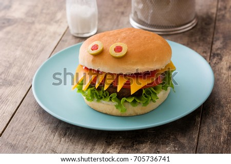 Halloween Burger Monsters On Wooden Table Stock Photo 705736741 ...