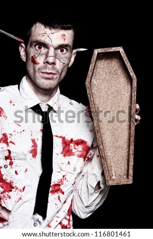 Halloween Businessman Covered In Blood Holding Open Funeral Casket On Black Background - stock photo