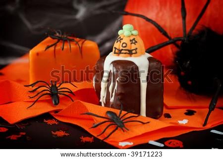 Halloween cakes on orange serviette - stock photo