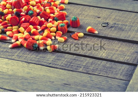 Halloween Candy Corn in Pile Spread on Rustic Textured and Weathered Wood Background with room or space for copy, text, your words.  Horizontal instagram  - stock photo