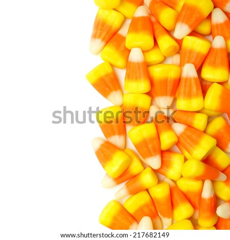 Halloween candy corn vertical border over a white background                    - stock photo