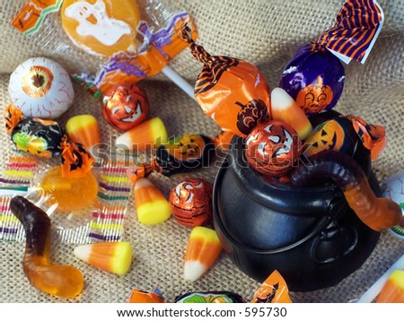 Halloween candy in a mini plastic witches cauldron. - stock photo