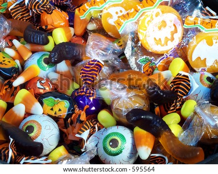 Halloween candy in a plastic witches cauldron. - stock photo
