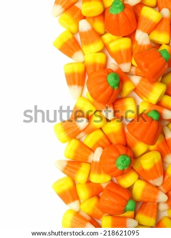 Halloween candy vertical border over white - stock photo