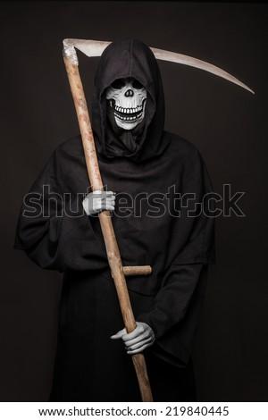 Halloween character: Death. Studio portrait on black background    - stock photo