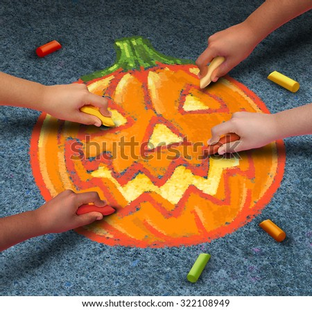 Halloween children drawing a jack o lantern pumpkin with chalk on the outdoor pavement as festive autumn season symbol for community participation in fun activities. - stock photo
