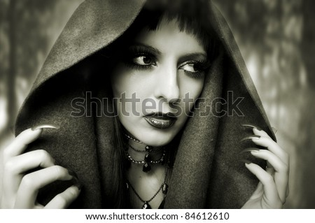 Halloween concept. Fashion portrait of witch or night vampire woman. Dark gothic makeup - stock photo