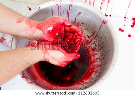 Halloween concept : Hand in blood on a white background