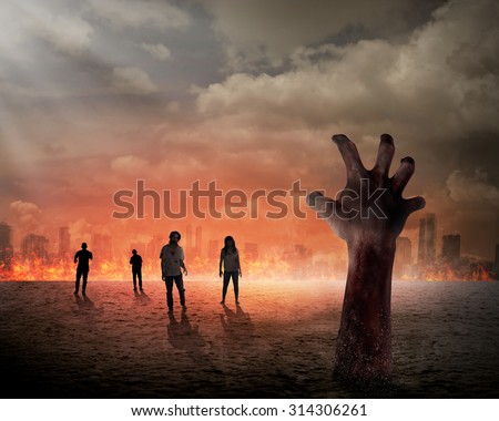 Halloween concept, zombie hand rising out from the ground - stock photo