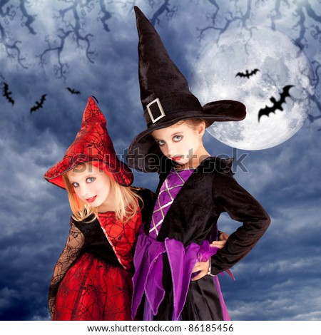 halloween costumes kid girls on moon night sky with bats [Photo Illustration] - stock photo