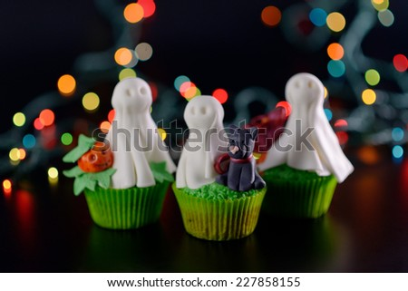 Halloween cupcake decorated with sugar black cat selective sharpness. - stock photo
