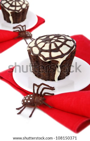 Halloween cupcake with a  spider web and spider - stock photo