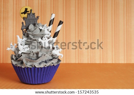Halloween cupcake with ghosts and castle - stock photo
