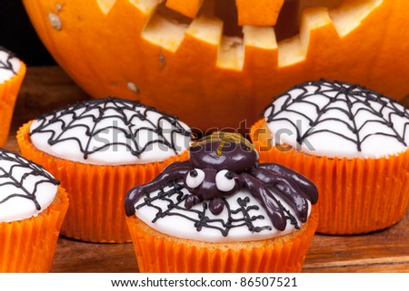 halloween cupcakes with spider and web. - stock photo