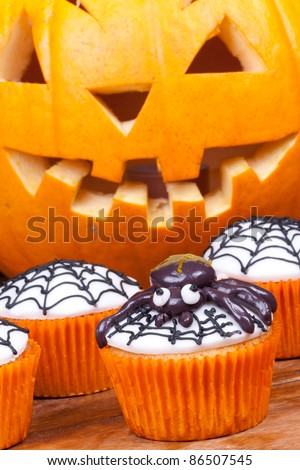 halloween cupcakes with spider and web vertical picture. - stock photo