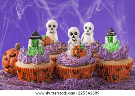 Halloween cupcakes with witches and  ghosts - stock photo