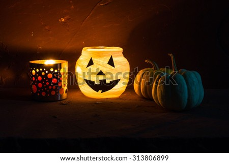 Halloween decoration on stone table over grunge background, selective focus - stock photo