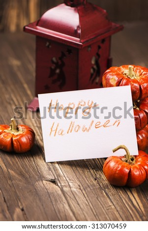 Halloween decoration: pumpkins with vintage lantern. Autumn or harvest concept. Happy Halloween vintage greeting card. Selective focus. Toned image - stock photo