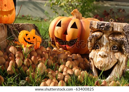 Halloween decoration with pumpkin and tree stump. - stock photo
