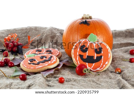 Halloween decorative cookies and pumpkins as popular American event party dessert idea. Isolated on white background