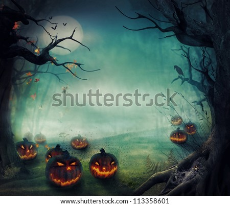 Halloween design - Forest pumpkins. Horror background with autumn valley with woods, spooky tree, pumpkins and spider web. Space for your Halloween holiday text. - stock photo
