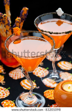 Halloween drink and chocolate dipped pretzels for Halloween - stock photo