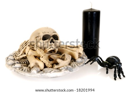 Halloween, fun and creepy, skull and bones with spider and candle on white background - stock photo