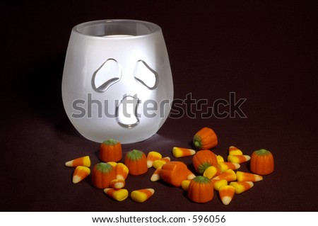 Halloween ghost and candy - stock photo