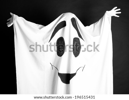 Halloween ghost, on dark background - stock photo