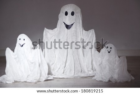 Halloween ghosts, on dark background - stock photo