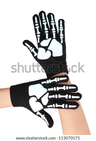 halloween gloves with skeleton print isolated on white - stock photo