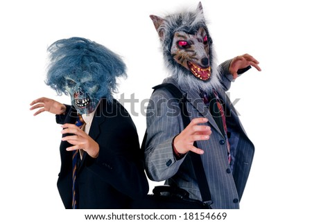 Halloween greedy businessmen wearing Halloween mask.  studio shot, white background