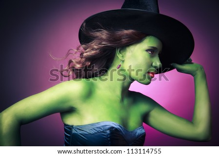 Halloween green witch on a pink background