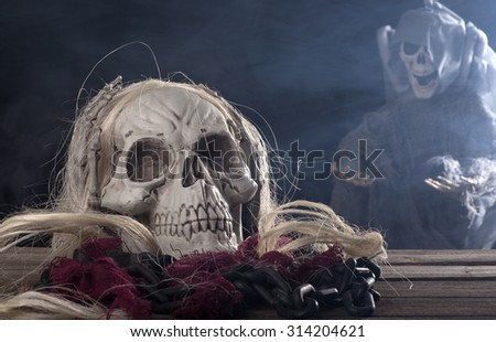 Halloween grim reaper with a spooky background - stock photo
