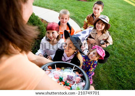 Halloween: Group Of Kids Want Halloween Candy - stock photo
