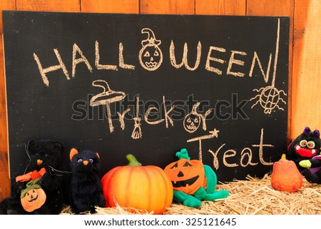 Halloween Hand Drawn on chalkboard with halloween doll on a bale