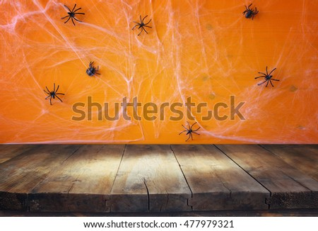 Halloween Holiday Concept Empty Rustic Table In Front Of Spider Web Background Ready For