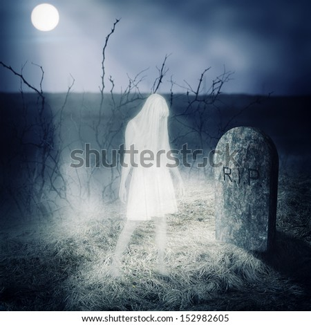 Halloween horror concept - afterlife. White woman ghost stay on her grave on old  cemetery  - stock photo