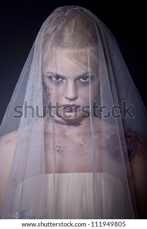 Halloween: Horror scene of a corpse bride standing. Shot in studio. - stock photo