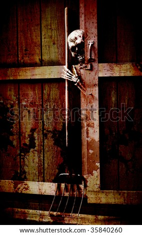 halloween horror scene - skeleton peeking out of a bloody shed reaching for a pitchfork - stock photo
