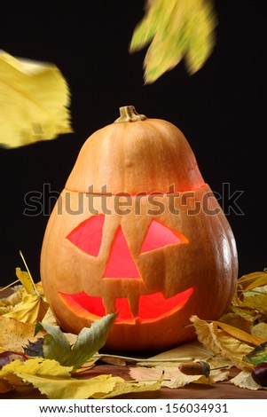 Halloween Jack o Lantern and falling leaves